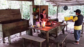 Dona Bette and Bor cooking in the historical camp kitchen of Lacandón Maya advocates Frans and Trudi Blom.