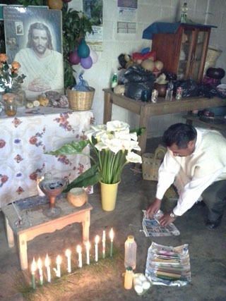 Don Xun Calixto laying the curing altar