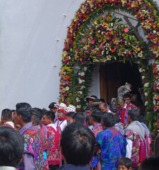 Processional leaving the Maya church in Zinacantan