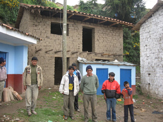 Two-story bathroom with Mollamarka community leaders, in building process as of March 2010